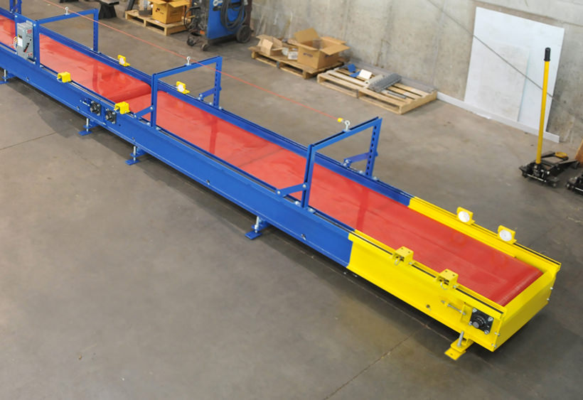 Heavy duty slider bed conveyor with cut resistant belt
