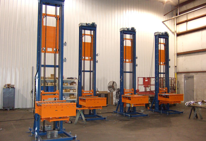 Two post lifts with belt driven roller conveyors