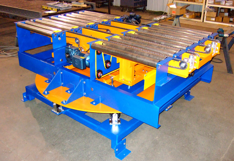 Powered turntable with belt driven roller conveyor and chain transfer mounted