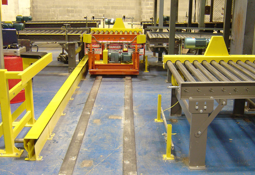 Powered transfer car with CDLR conveyor for single pallet, installed