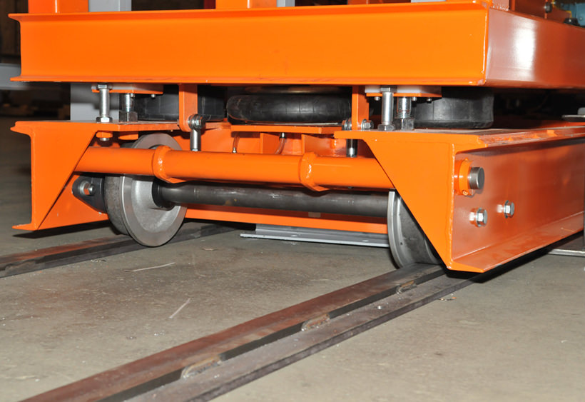 Transfer car with cantilevered chain conveyor under carriage view