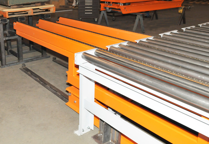 Transfer car with cantilevered chain conveyor designed for AGV loading