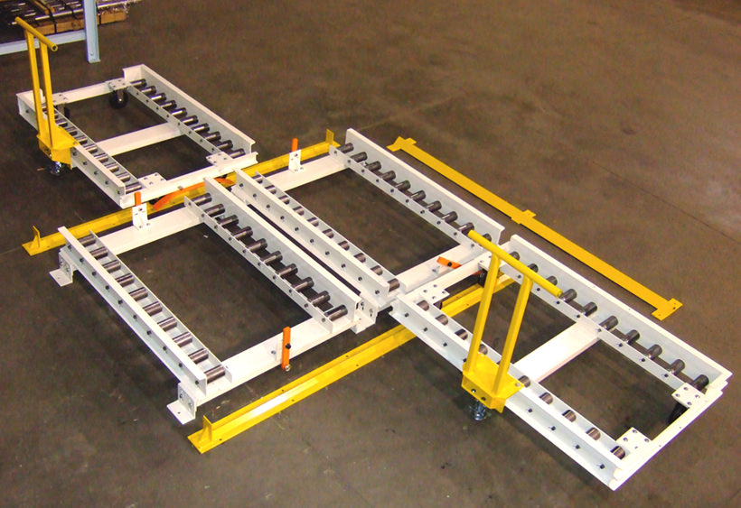 Two manual transfer cars with a gravity conveyor system