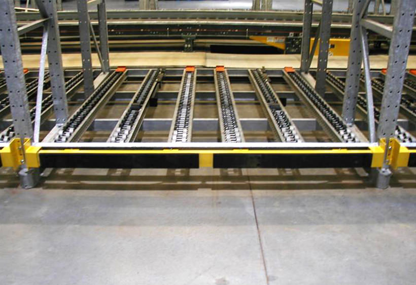 Pallet rack protection bumpers with leaf springs
