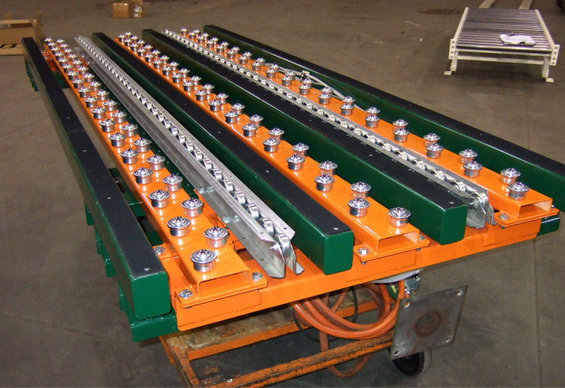 Multiple purpose conveyor mounted on a lift table