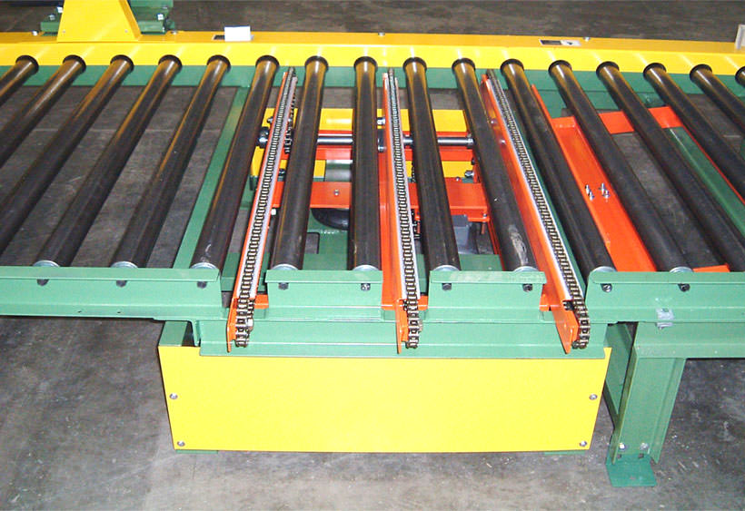 Three strand chain transfer mounted in CDLR conveyor, through the frame