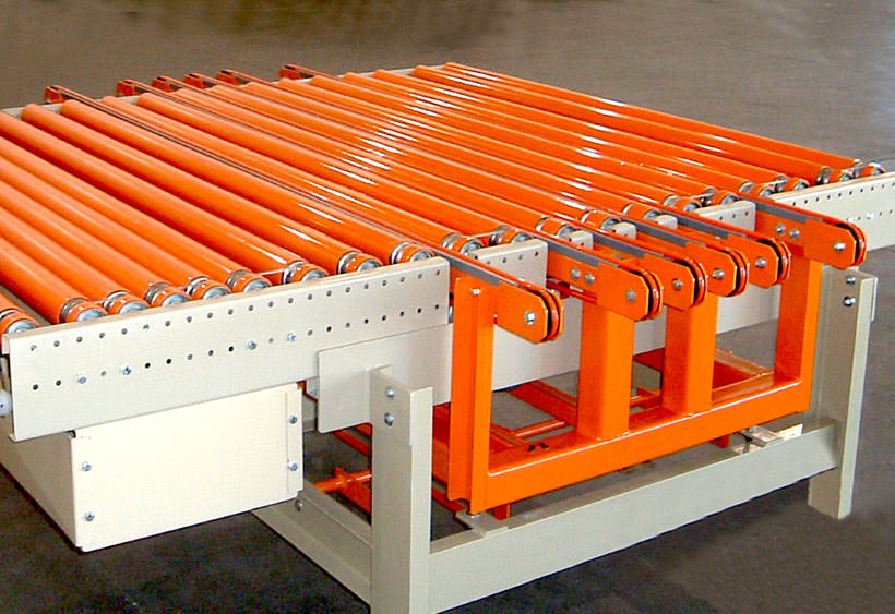 Multi strand round belt transfer mounted in lineshaft conveyor