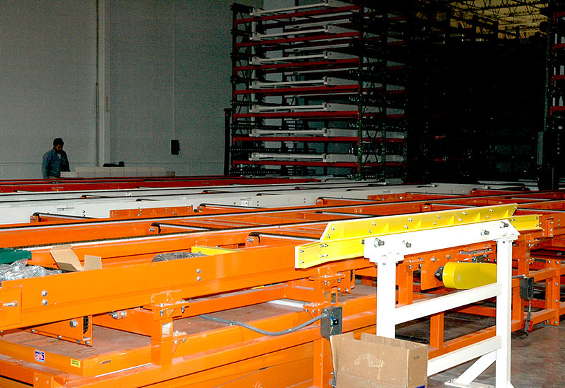 Chain conveyor and pallet queue zones prior to curing oven