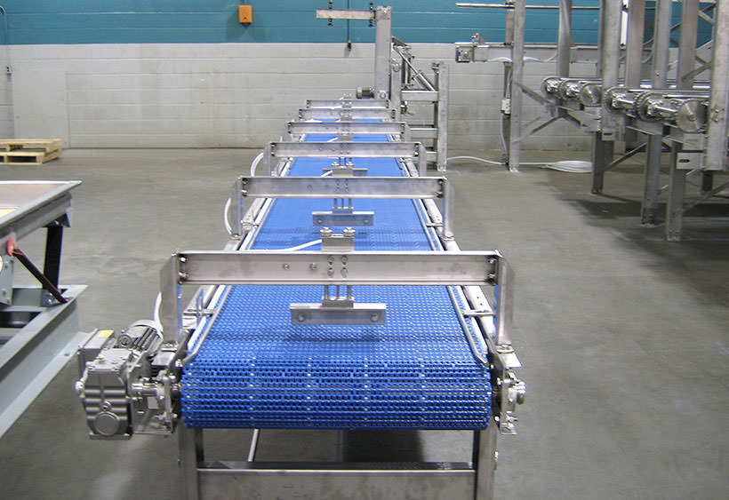 Product tray positioning conveyor during installation
