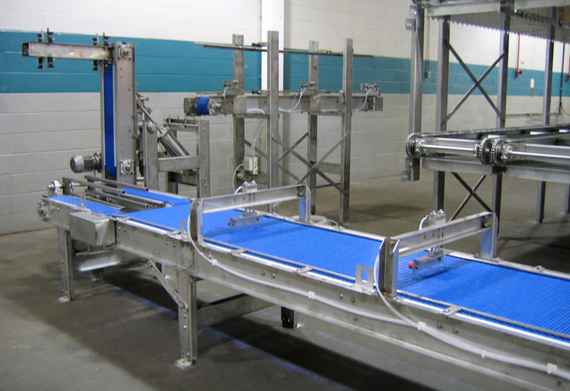 Product tray orientation change and positioning conveyor during installation